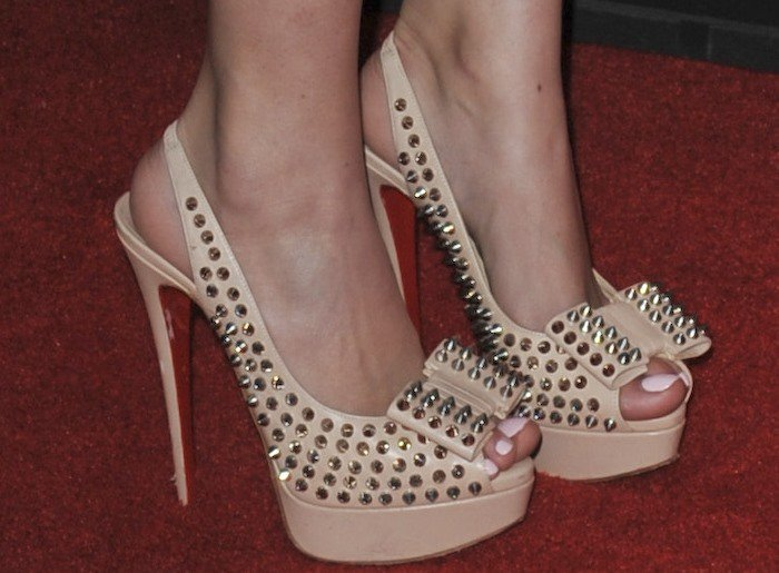Christian Serratos's feet in spike-and-bow embellished Christian Louboutin heels