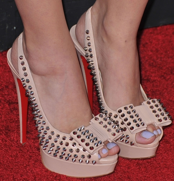 Christian Serratos shows off her sexy feet in Christian Louboutin Clou Noeud heels