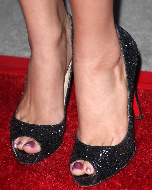 Christian Serratos shows off her feet in Christian Louboutin peep-toe shoes