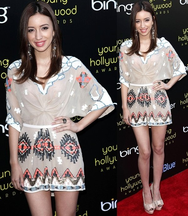 Christian Serratos wears at AllSaints dress at the 13th Annual Young Hollywood Awards