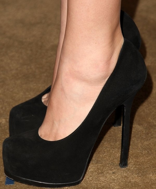 Christian Serratos shows off her feet in black platform pumps