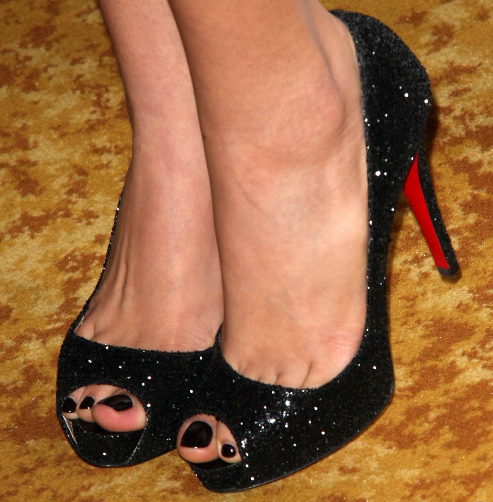 Christian Serratos shows off her size 8.5 (US) feet at the 36th annual Vision Awards