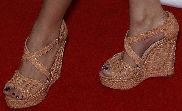 Christian Serratos displays her pretty feet in hot wedges