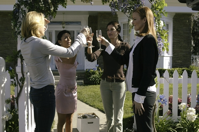 Felicity Huffman (as Lynette Scavo), Eva Longoria (as Gabrielle Solis), Teri Hatcher (as Susan Mayer), Marcia Cross (as Bree Van De Kamp) in the pilot episode of the American dramedy-mystery series Desperate Housewives that premiered on October 3, 2004