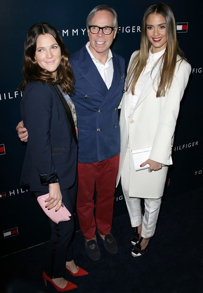 Drew Barrymore, Tommy Hilfiger, and Jessica Alba attend a party to celebrate the opening of the new Tommy Hilfiger West Coast Flagship store on Robertson Boulevard February 13, 2013