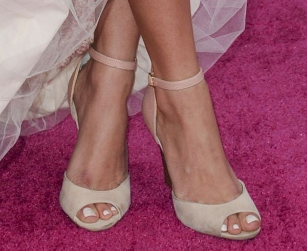 Emily Osment showing off her sexy feet
