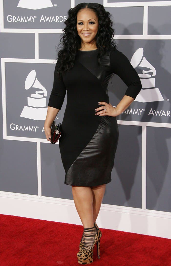 Erica Campbell in a black fitted dress at the 55th Annual Grammy Awards in Los Angeles, California on February 10, 2013