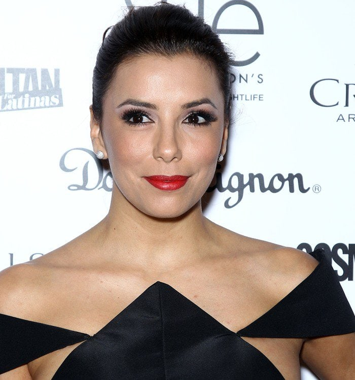 Eva Longoria wears her hair back at the grand opening of SHe by Morton's