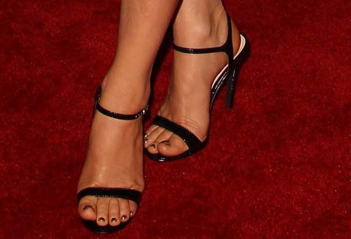 Fergie's sexy feet in ankle-strap sandals