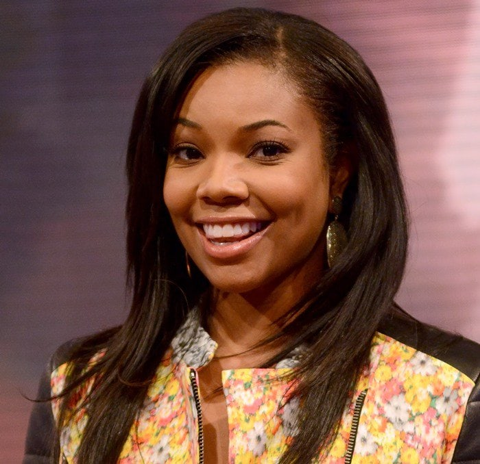 Gabrielle Union accessorized with oversized earrings that added a nice bit of metal without being too gaudy or over the top