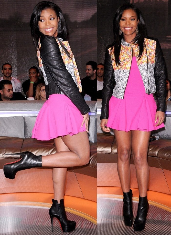 """Gabrielle Union paired her platform booties with a bright pink mini dress from the DSquared2 Resort 2013 collection and a cool Yigal Azrouël leather & floral """"Ikat"""" print jacket"""