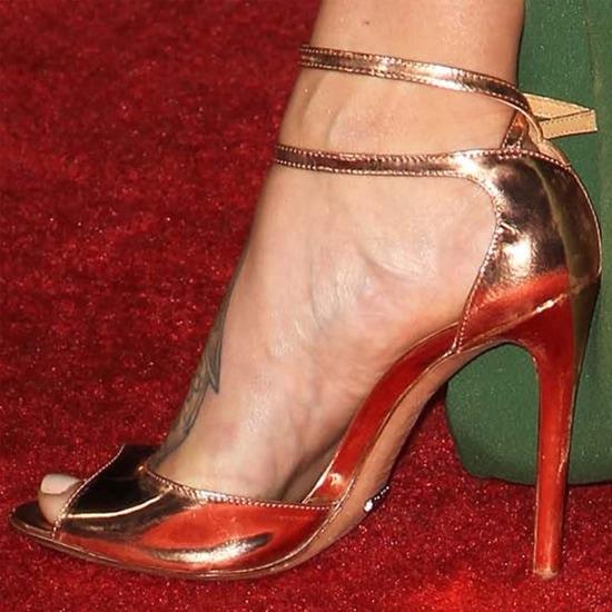 Genesis Rodriguez showing off her feet in Jimmy Choo sandals