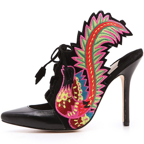 Vibrant embroidered birds detail the sides of these elaborate Isa Tapia shoes, which are fashioned with a lace-up front and a low-cut vamp