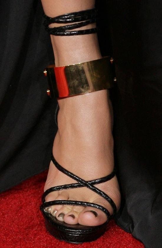 Jennifer Lopez wearing ankle-wrap Tom Ford sandals