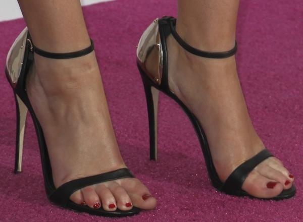 Jennifer Lawrence's feet in gold plated Giuseppe Zanotti sandals