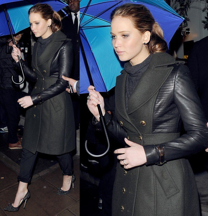 Jennifer Lawrence wearing an all-black ensemble and wreaking of Jackie-O glam