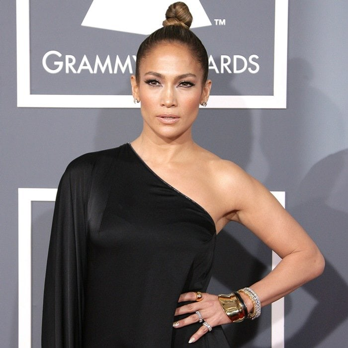 Jennifer Lopez with shiny and sparkly baubles on her wrist and fingers