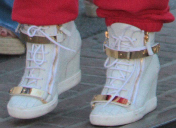 b46817bcc78d Jennifer Lopez in Gold-Tone Hardware Giuseppe Zanotti Sneakers