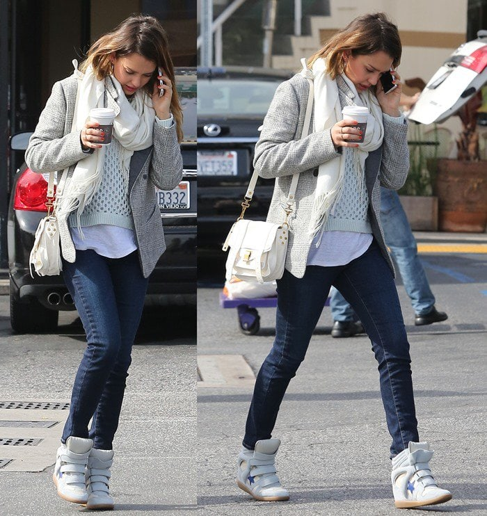 Jessica Alba wears a casual outfit with a pair of blue-and-white wedge sneakers
