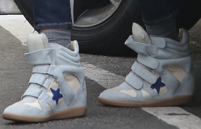 Jessica Alba wears a pair of star-embellished Isabel Marant wedge sneakers