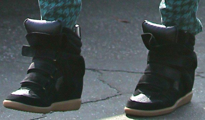 Jessica Alba wears a pair of black Isabel Marant wedge sneakers