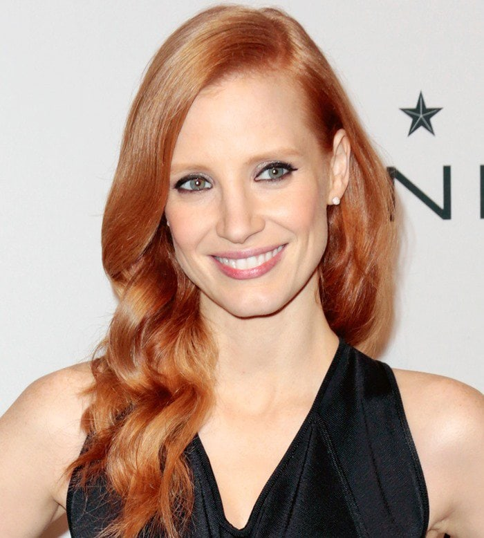 Jessica Chastain's signature red hair with 1940s-inspired waves