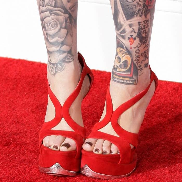 Kat Von D wearing red Alexander McQueen wedges