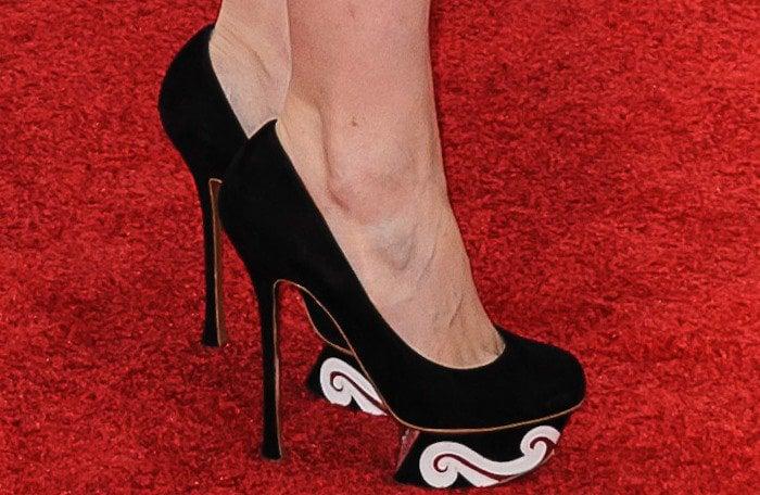 "Kate Mara's feet in red, black and white ""Swirl"" pumps"