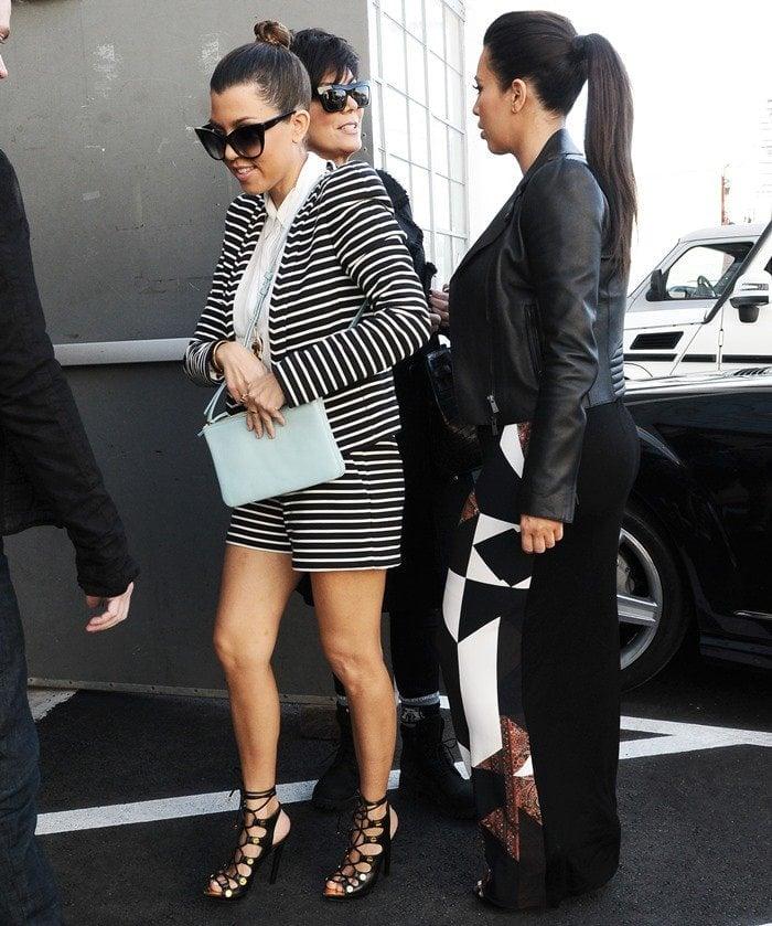 Kourtney Kardashian totes a Celine Trio crossbody bag in glacier blue