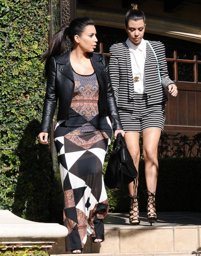 Kim and Kourtney Kardashian spotted shopping while filming their reality show 'Keeping Up With The Kardashians' in Los Angeles