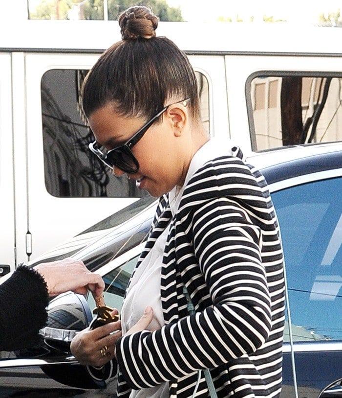 Kourtney Kardashian rocks black Dita Magnifique sunglasses
