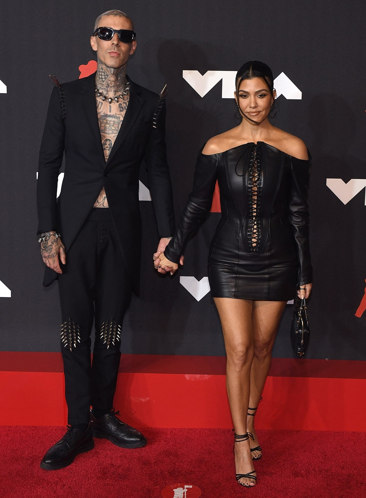 Kourtney Kardashian and Travis Barker walk the red carpet at the 2021 MTV Video Music Awards
