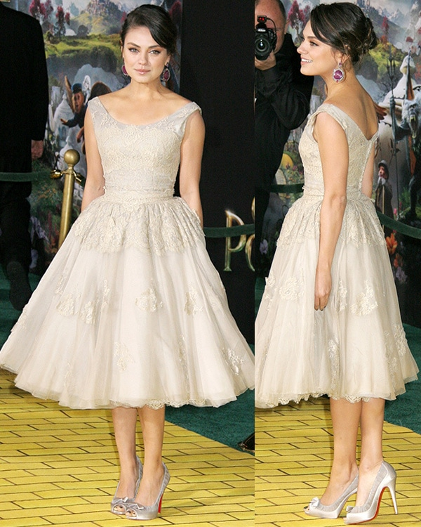 Mila Kunis flashed her legs at the Los Angeles premiere of Oz: The Great and Powerful