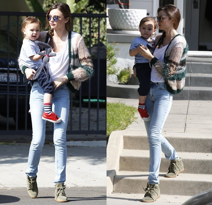 Miranda Kerr flaunted her legs in skinny jeans and Isabel Marant's Bobby sneakers