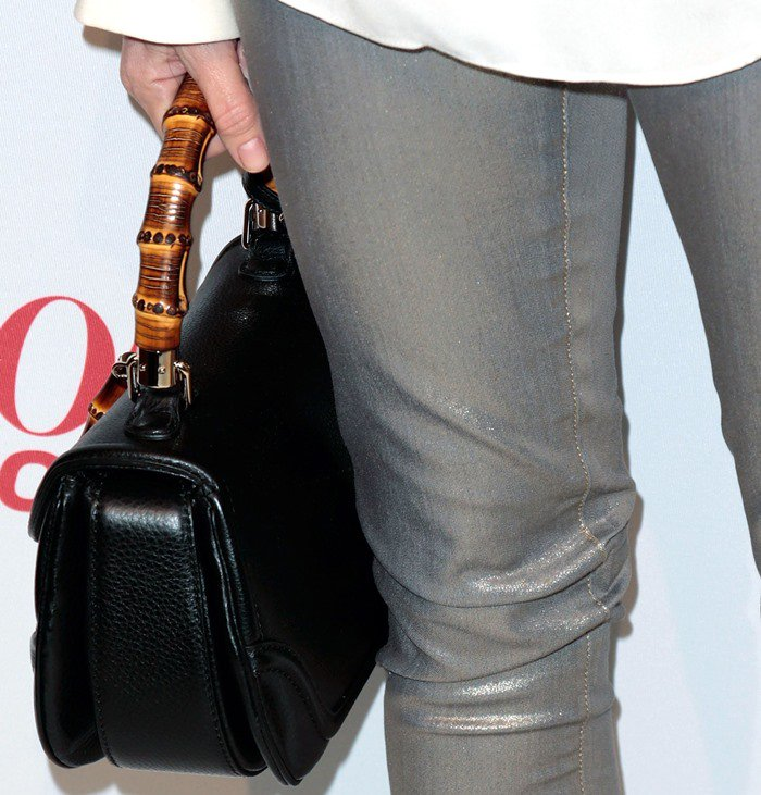 """Naomi Watts toted a black leather Gucci """"New Bamboo"""" top handle bag"""