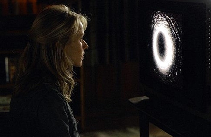 Naomi Watts as Rachel Keller watches the cursed videotape in The Ring