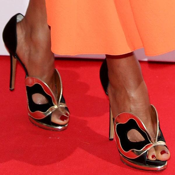 Naomie Melanie Harris shows off her feet in Nicholas Kirkwood shoes