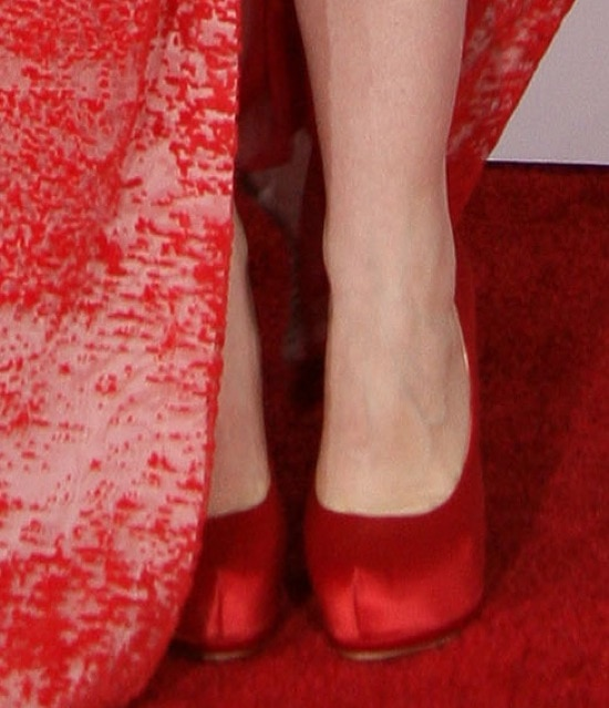 Natasha Bedingfield wearing red satin pumps