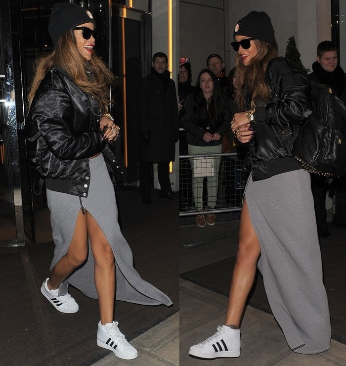 Rihanna wearing a long maxi skirt, a black leather jacket, and a black beanie