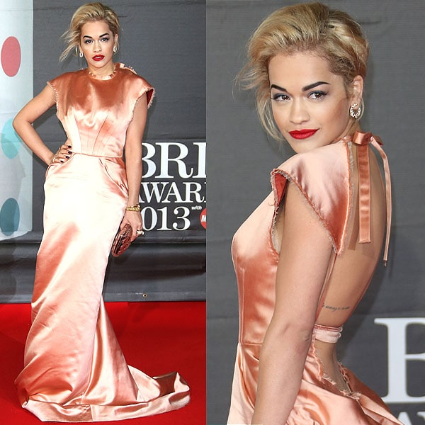 Rita Ora wearing a peachy rose Ulyana Sergeenko Couture gown and a custom made snake ring by Jennifer Fisher