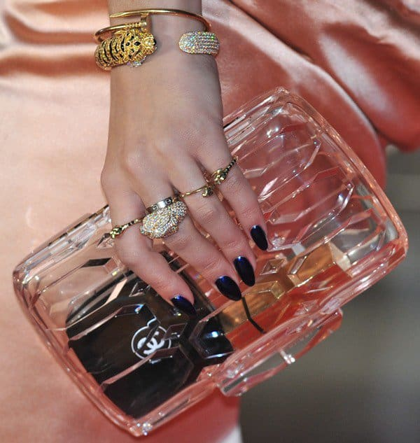 Rita Ora carrying a Gucci Spring 2013 perspex clutch
