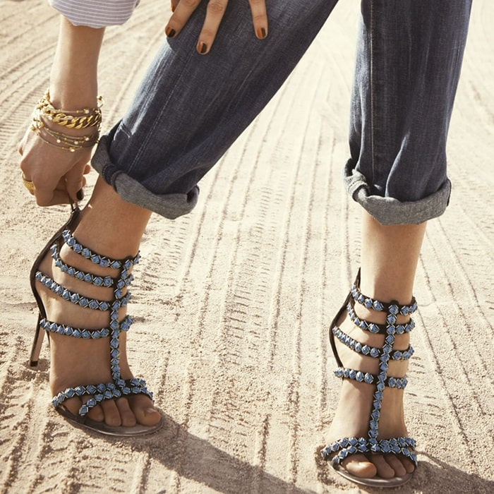 Geometric beads traces the precision straps of a striking suede sandal balanced atop a slim heel