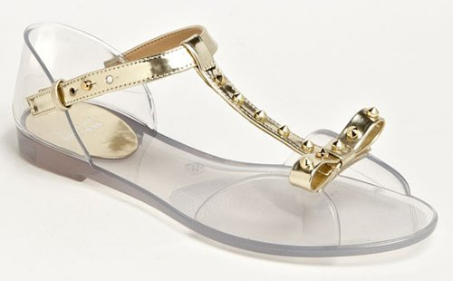 A studded golden T-strap glams up a charming, flexible jelly sandal