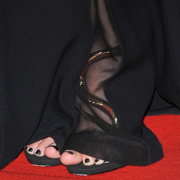 Taylor Swift's sexy toes inGiuseppe Zanotti gold serpent sandals
