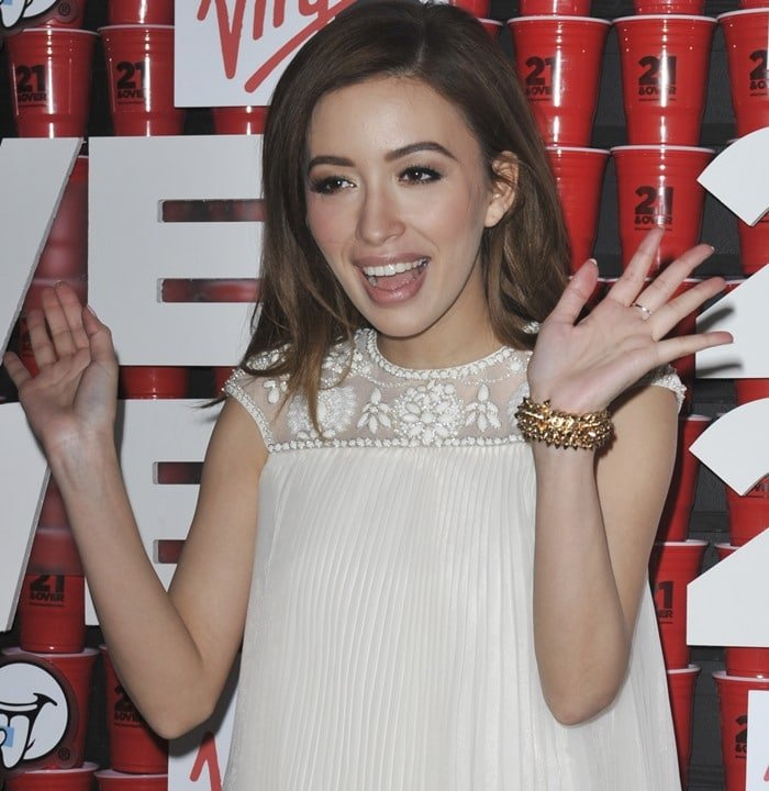 Christian Serratos wears her hair down at the Los Angeles premiere of 21 & Over