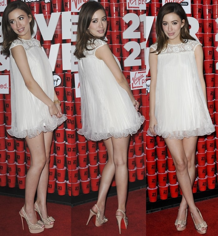 Christian Serratos wears a white baby doll dress on the red carpet