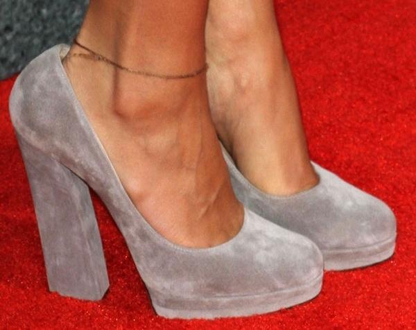 Rashida wearing grey suede Casadei pumps