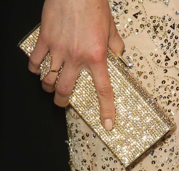 Adrianne carried a Daniel Swarovski gold crystal 'Lana' box clutch