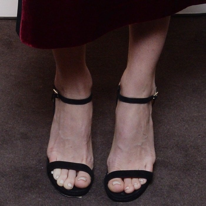 Alice Eve's naked feet in black ankle strap sandals