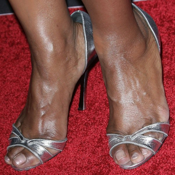 Angela Bassett shows off her size 7 (US) feet in silver d'Orsay sandals